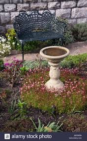 ornamental seat and bird bath in an garden derbyshire