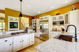 light yellow kitchen with white cabinets farm house interior luxury kitchen room in bright yellow color