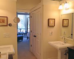 master bathrooms are accessed by walk through closets that can be