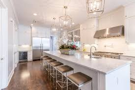 white kitchen island with gray barstools transitional kitchen