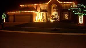 how to hang lights on house how to hang christmas lights on your garage angie s list