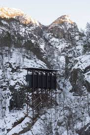 peter zumthor installs modest buildings erected on black winged