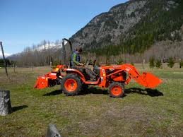 kubota b2320 specs price backhoe loader mower and review
