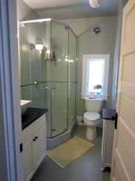 glass shower cabin partition walls gray wall paint toilet mirror