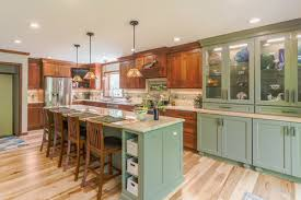 mixing kitchen cabinet wood colors 3 warm kitchens that mix blue green and wood cornerstone