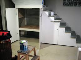 Remodeling Basement Stairs by Hidden Built In Storage And Shelves Under Basement Stairs Design
