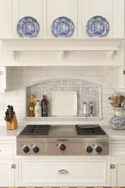 suzie hendel homes country kitchen with white wood paneled