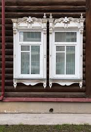 wooden window with carved wooden ornaments open windows