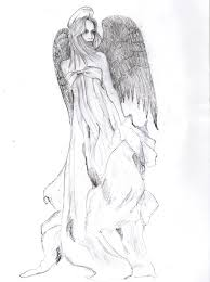 sad angel tattoo design on back photos pictures and sketches