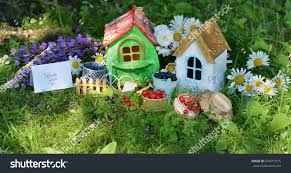 Summer House For Small Garden - two small houses berry flowers text stock photo 694557475