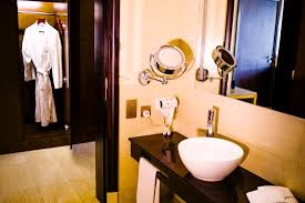 separate shower and bathroom with a hair dryer weighing scale