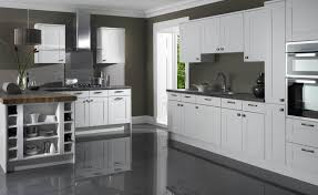 good looking white shaker kitchen cabinets grey floor subway tiles