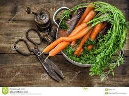 fresh carrots with vintage kitchen utensils country style food