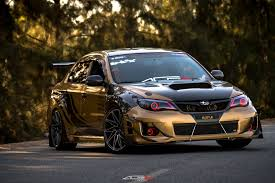 subaru station wagon wrx subaru wrx station wagon sporting gold custom painted rims by
