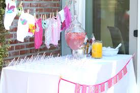 baby shower cake table decor pink tissue paper pom pom candy
