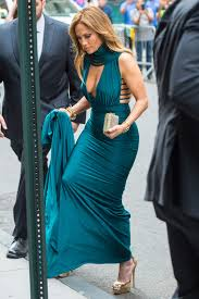 j lo jennifer lopez went glam in a teal gown gold stilettos at a