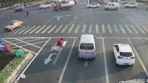 chinese man caught painting his own road signs daily mail online