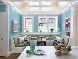 traditional dining room with wall sconce by s h construction