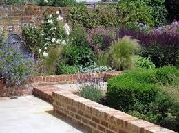 brick garden walls perennial border bronze fountain