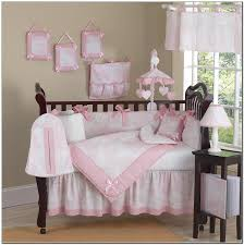 Pink Laminate Flooring Beige Wall Theme With Brown Polished Wooden Baby Crib Having Pink