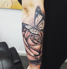 tattoo roses on shoulder 28 awesome butterfly tattoos with flowers that nobody will tell
