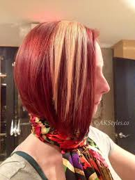red brown long angled bobs red with blonde pannel haircolor with a short angled bob haircut