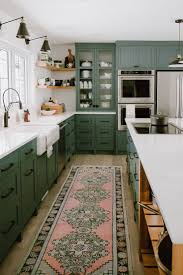 green kitchen cabinets with white countertops pin on home