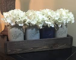 custom made rustic planter box with 5 painted mason jars