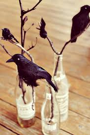 black crow centerpiece in vintage soda bottles halloween