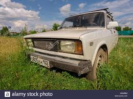 lada old white russian lada car outside parked on grass stock photo