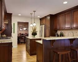 stained kitchen cabinets with hardwood floors rich cabinets w hardwood floors and granite