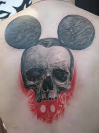 skull back mickey mouse tattoo by elvin tattoo