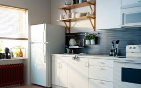 brown wooden wall mounted shelves over white wooden cabinet and