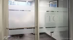 door film for glass distraction markers on glass panels and doors in commercial space