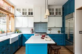 blue base kitchen cabinets creating a color blocked kitchen board vellum