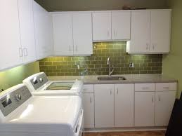 Decorating Laundry Room Walls by Laundry Room Sinks Set In Brown Floor Green Wall Painting And