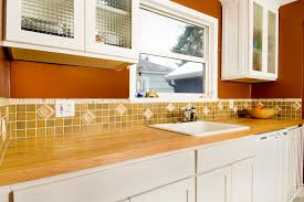 butchers block countertop on white kitchen cabinet with u shaped
