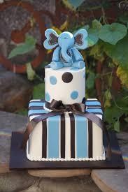 blue baby shower cake with elephant topper baby shower cakes