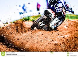 extreme motocross racing motocross biker accelerating in a curve with flying mud and debris