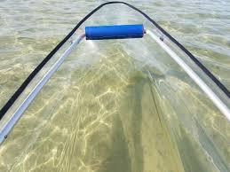 crazy fast bull shark hitting a clear kayak canoe hybrid gif
