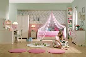 Vintage Small Bedroom Ideas - adorable pink white color scheme patterned varnished wooden floor