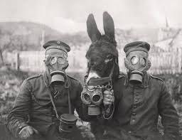 vintage masks a and two german soldiers wearing gas masks during world