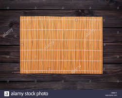 Bamboo Table Top by Bamboo Mat On A Wooden Table Top View Stock Photo Royalty Free