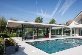 pool house glass and concrete pool house by lieven dejaeghere