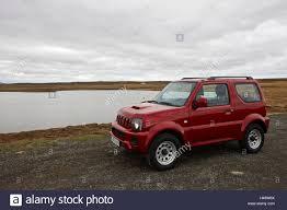 suzuki jimny off road suzuki jimny 4x4 off road hire car by a lake in thingvellir