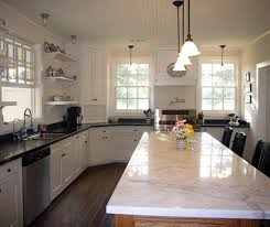 marble island kitchen white marble island with black granite countertops the