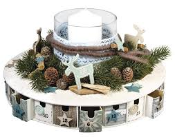 wreath shaped paper mache advent calendar makes a lovely table
