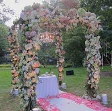 wedding arches and arbors four designers floral wedding arbor decorating tips