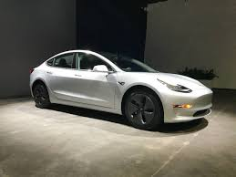 tesla delays standard model 3 deliveries by almost a year