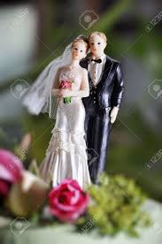 and groom figurines and groom figurines on wedding cake stock photo picture and